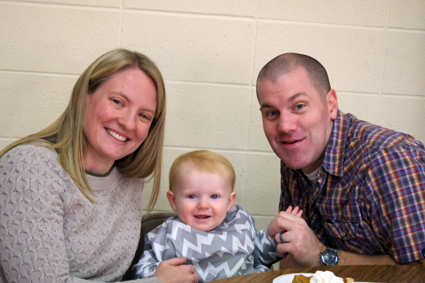 At left, David, Missy, and 14-month-old Grace Wilson.