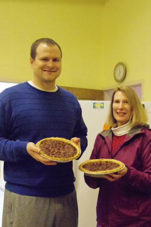 Suzanne Grafinger and her son-in-law Kyle Vuchak deliver homemade pecan pies.