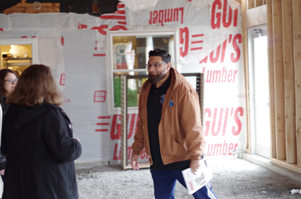 Fahim Mojawalla, owner of the Island Ship Center, describes to visitors the expansion going at his business, located at 1879 Whitehaven Road.