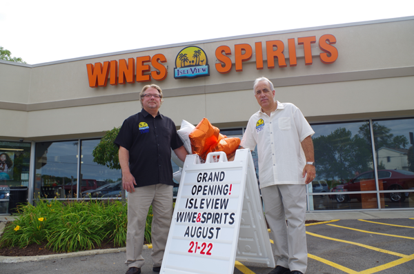 Grand Islanders Jim Atkinson, left, and Tom Corrao welcome patrons to their new store, IsleView Fine Wines & Spirits at 533 Niagara St. in Tonawanda. (Photos by Larry Austin)