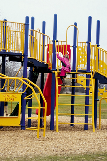 "A child enjoys the new playground that David Brand, Chair of the Kaegebein Playground Committee, said is compact and has ""so much to do."""