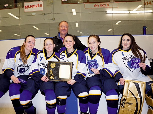 Five Kenmore/Grand Island hockey players, all from Grand Island, will play for a state hockey championship this week in Albany after winning the Section VI girls hockey title Wednesday. Pictured with Grand Island Athletic Director Jon Roth are, from left: LeeAnn Wright, Rosie Boyko, Abby Blair, Tori Botticello and Andrea Colan. (Photos by Larry Austin)