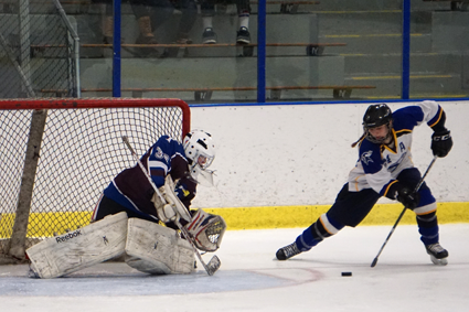 Olivia Smith scores the clinching goal in a 4-2 win for Kenmore/Grand Island over Orchard Park/Frontier. She sent a backhander into the roof of the net over OP/Frontier goalie Victoria Cottrell. (Photo by Larry Austin)