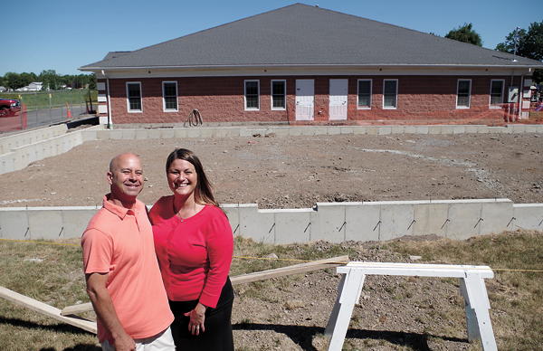 Jason and Ann MacClellan of Island Kids Child Care Center, Preschool and PreK are pictured at their school on Ransom Road, where a major expansion is taking place. (Photo by Larry Austin)