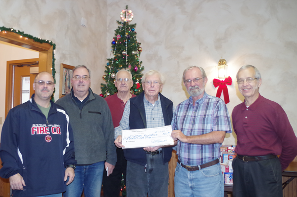Pictured at Thursday's check presentation are, from left: Neighbors Foundation representatives Dave Khreis and Denny Dahl, Knight Dick Dietrich, Neighbors Foundation President Henry Kammerer, Bill Gworek Sr. and Knight Peter Kuszczak. (Photo by Larry Austin)
