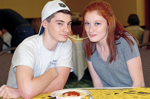 Ed Logel and Lu Goc, volunteers with Young Life, recreate the scene from `Lady and the Tramp.`
