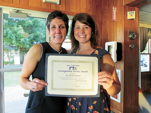 Grand Island Superintendent of Schools Teresa Lawrence, left, received the PTA Distinguished Service Award from PTA Council President Lisa Fabiano.