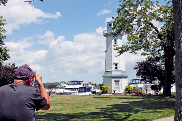 Paul Leuchner uses a sextant to establish the height of the Buffalo Launch Club's range light on East River Road. The measurement is made from the base to the light of the beacon. (Photo by Karen Carr Keefe)