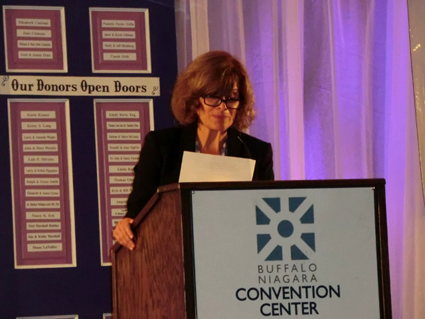 Mary Travers Murphy, executive director of the Family Justice Center, discusses issues connected with domestic violence at the Voices Ending Violence breakfast June 12 at the Buffalo Convention Center.