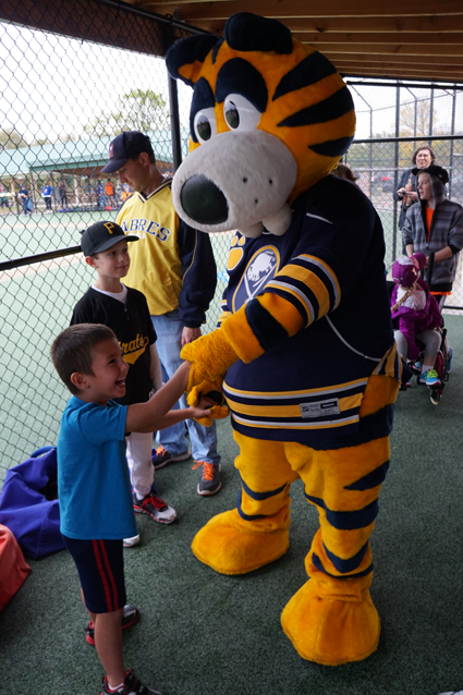 Sabretooth stepped out of the rain and greeted Miracle Leaguers in their dugout.