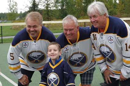 Sabres Alumni Craig Muni, Richie Dunn and Rene Robert signed autographs and posed for pictures with Miracle League players before taking the field. (Photo by Larry Austin)