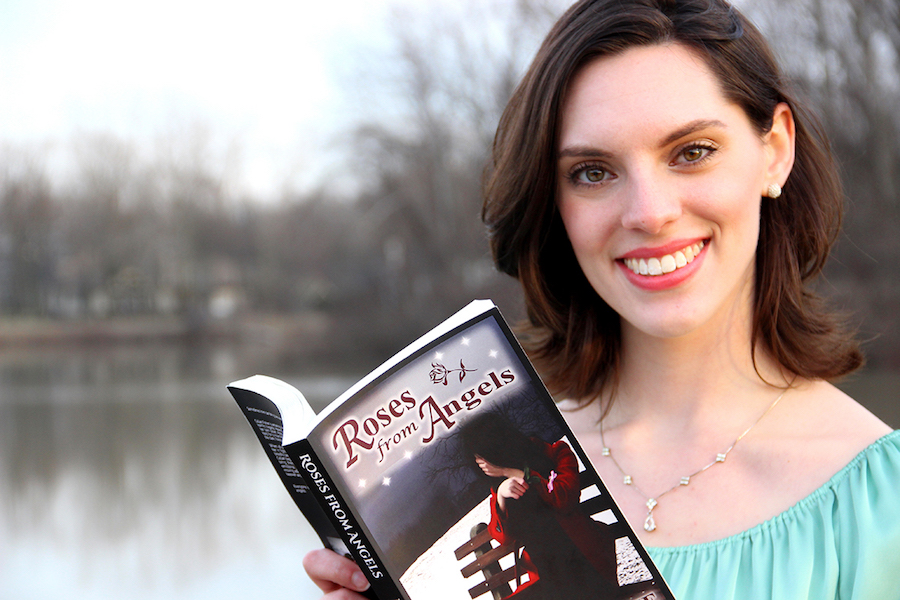 Rachael Ruszkowski stands with her novel, `Roses from Angels.`