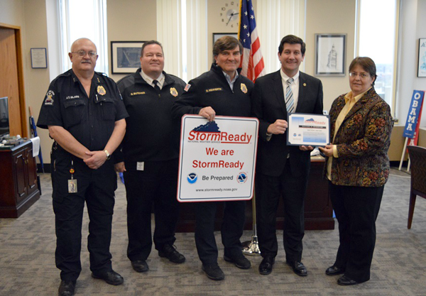 Erie County Executive Mark C. Poloncarz (second from right) accepts StormReady certification from Judith Levan, acting meteorologist in charge at the National Weather Service Forecast Office in Buffalo. Joining Poloncarz and Levan are, from left: J.T. Glass and Gregory Butcher of the Erie County Emergency Services Department, along with Commissioner Dan Neaverth Jr. (center).