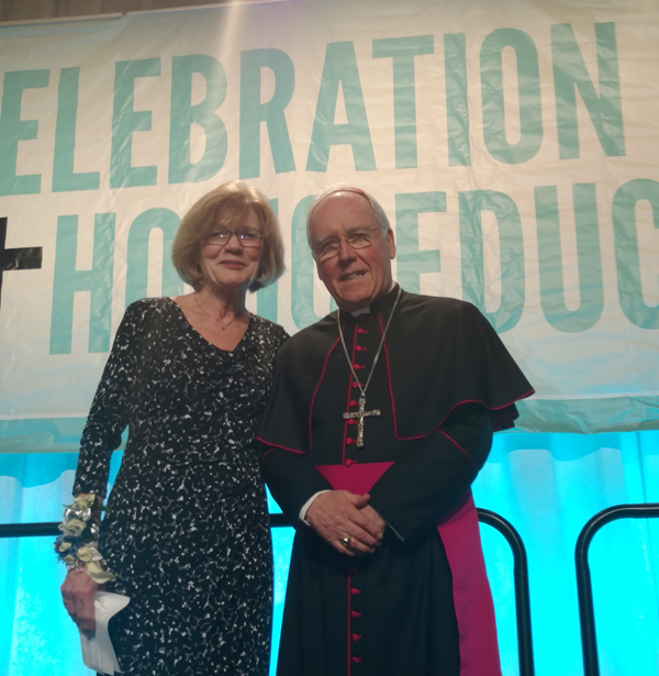 Judith Nolan Powell received the Bishop's Medal from the Most Rev. Richard J. Malone, bishop of the Diocese of Buffalo. (Photo by Mike Billoni)