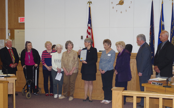 Pictured, Town Supervisor Mary Cooke presents the proclamation to members of the Golden Age Club, from left: Debi Acomb, Linda Clark, Editha Germain, Martha Muller, Gloria Diringer and Chris Bihler. (Photo by Larry Austin)