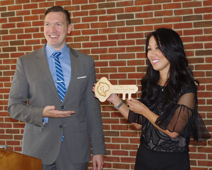 Town Supervisor Nathan McMurray presents Kim Pegula with a key to Grand Island Wednesday during a press conference announcing the One Buffalo Cupcake.