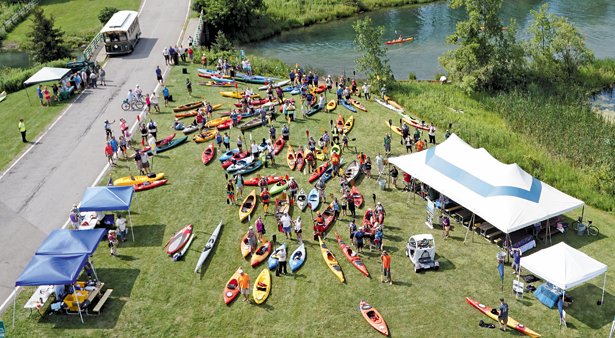 Participants hold their paddles up before departing from the starting point in the 10th annual `Paddles Up` Saturday at Beaver Island State Park. (Photos by K&D Action Photo and Aerial Imaging)