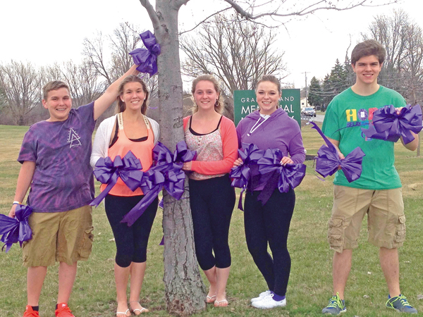 Relay For Lifers will be out and about April 25 decorating Grand Island with purple bows as part of Paint the Town Purple to raise awareness about Relay and its fight against cancer. Pictured, from left, are Alex Melisz, Haley Melisz, Danielle Duck, Gabby Robinson and Alex Garey with some of the bows residents will see all over the Island. To support Relay For Life, buy a bow at First Niagara Bank from 9 a.m. to noon April 25, or visit DeSignet International, 1869 Whitehaven Road. Large bows are $5 and small bows are $1.