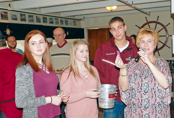 Kim Nemeth pulls the winning 50-50 raffle ticket during Saturday's Pasta Sauce-Off event held at the LaSalle Yacht Club. The event is a fundraiser for Carly's Club of Roswell Park Cancer Institute. Also pictured, from left, are event organizers Jessica Flash and Allyson Nemeth, and volunteer Ryan Costolnick. (Photo by Larry Austin)