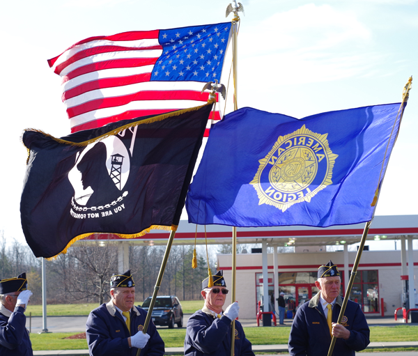 A noontime ceremony at the flagpole at the DeGlopper VFW Post marked the 75th anniversary of the attack on Pearl Harbor. (Photos by Larry Austin)
