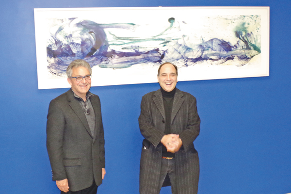 Bill Whitford, left, and Neil Tetkowski attended the unveiling of `Perilous Flow,` Tetkowski's artwork in the Viking Mall of Grand Island High School (Photo by Larry Austin)
