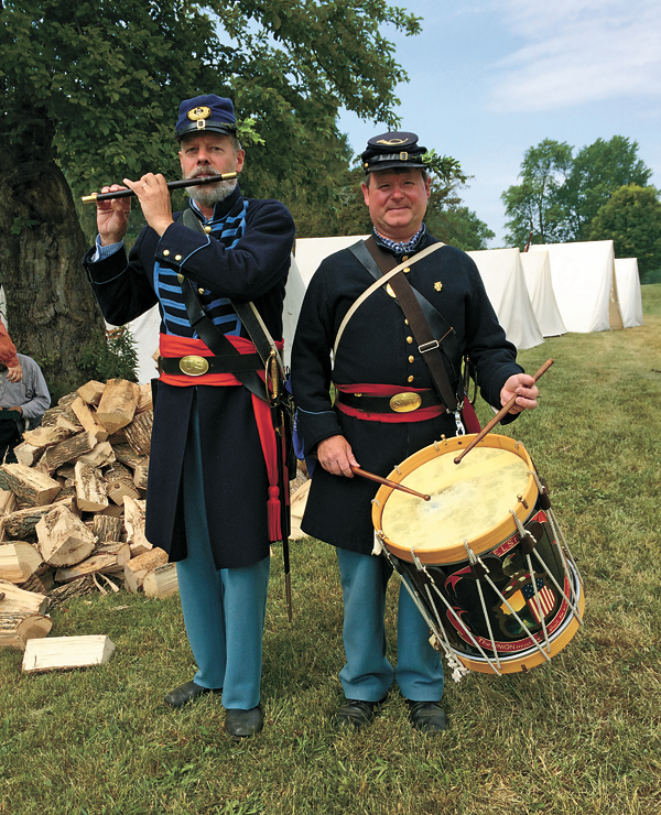 Jim Pace, left, playing the fife, and Brian Seibel, playing the drum, comprise the Union Volunteers Fife & Drum Corps. Here, they perform in Fort Erie, Ontario, for the 150th anniversary of the Fenian Invasion, which occurred one year after the Civil War. Pace and Seibel will perform military field music of the American Civil War as part of their presentation at 7 p.m. Nov. 3 at Historic Trinity Church in a program sponsored by the Grand Island Historical Society. (The Fenian Invasion involved Civil War Irish veterans on both sides of the conflict. The plan was to take over Canada and hold it hostage until Britain released Ireland.)