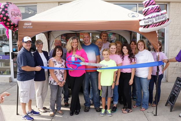 Cindy Inman, joined by her husband Jeff as well as friends, family, and business and government supporters, cut the ceremonial ribbon on Plumeria, her organic bath products store in the Tops plaza. Click for a larger image. (Photos by Larry Austin)