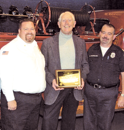 Dr. Edward Rayhill is flanked by past Grand Island Fire Chief Greg Butcher, left, and EMS captain Bob Cleveland.
