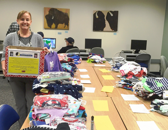 Mave Milligan, licensed real estate salesperson in RealtyUSA Tonawanda Office, helped spearhead The Pajama Program collection.