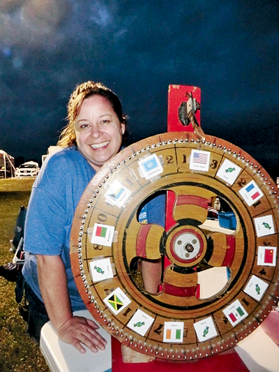 Jeanne Percival, captain of Huth's Heroes Relay For Life team, had a spinning prize wheel to raise money. (Photo by Alice Gerard)
