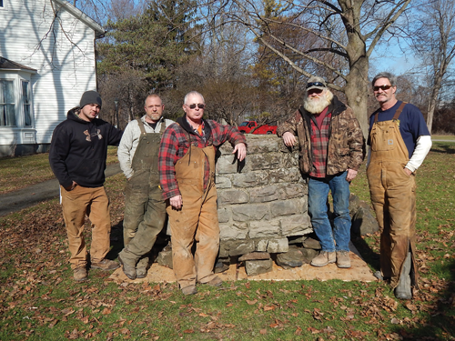 The LDC Construction crew poses near the well they recovered Feb. 2 from the Niagara River and moved into place at the River Lea mansion. From left, they are: Lyle Szapakowski, Greg Dinsmore, Mike Szapakowski, Jeff Dinsmore and Dan Dinsmore.