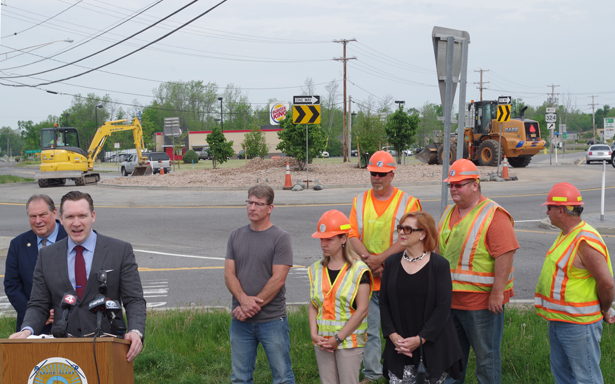 Town Supervisor Nathan McMurray speaks during a press conference highlighting the redesigned roundabout at the intersection of Staley Road and Grand Island Boulevard. (Photo by Larry Austin)