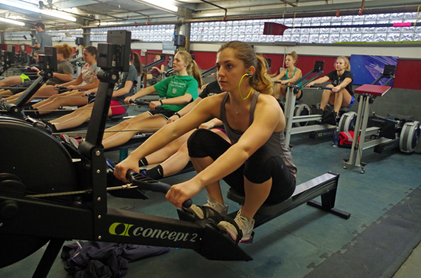 Sophia Castillo of Grand Island works out on the Concept 2 Dynamic Indoor Rower at the West Side Rowing Club. Castillo set a world record on the machine, called an ergometer, or erg. (Photo by Larry Austin)