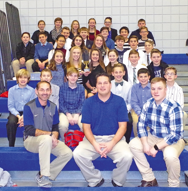 In the front row, from left, Veronica Connor Middle School teachers Dave Bowman, Mike Nucci and Christian Reed sit for a team picture with their students after winning Tech Wars for the third time in four years. Click to enlarge.