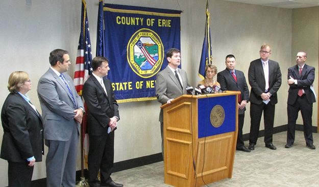 Erie County Executive Mark C. Poloncarz (at podium) is flanked by Erie County Health Commissioner Dr. Gale Burstein (right) and representatives of the Tower Foundation, Kaleida Health, Catholic Health, the United Way of Buffalo and Erie County, HealthNow New York Inc., and Univera to announce a $64,000 grant from the Peter and Elizabeth C. Tower Foundation to strengthen countywide efforts among health care providers to decrease opioid addiction.