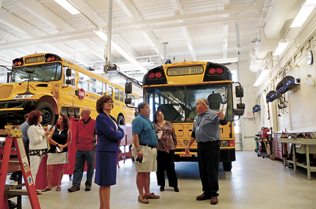 Chief mechanic Tim Blevins of the Grand Island Central School District Transportation Department gives a tour of the new Jack Burns Transportation Center Tuesday following a ceremonial ribbon-cutting and grand opening for the facility.