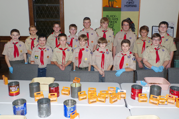 Boy Scout Troop 510 met at Trinity United Methodist Church Nov 10 to take on the task of sorting coinage collected as part of the 2016 Trick-or-Treat for UNICEF fundraiser. (Photo by Larry Austin)