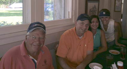 Island golfers Gary Roesch, Kevin and Sara Slachciak, and Kim Kalman enjoy a meal at the Village Inn following the Village Open on Sept. 13. (Photo by Dick Crawford)