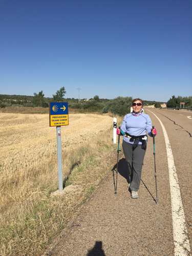 On Day 13 of her month-long journey, Zdenka Gast cools her weary feet. A typical day along the Camino de Santiago, or St. James Way, involves walking 10 miles or more in 100-degree heat mid-day along rugged terrain. Gast said she developed blisters the size of quarters.