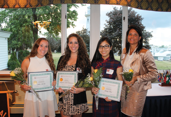 Zonta Club of Grand Island held its 2016 Scholarship Award night June 28 at the Buffalo Launch Club. From left are: scholarship winners Julia Lawley, Margaret M.H. Rustowicz and Yaling Chen (not shown, Megan Karpie); and guest speaker Bethany Bernatovicz, owner of ASI Signage and a former Zonta Scholarship winner. (Photo by Karen Carr Keefe)