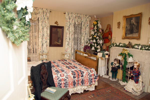 A bedroom in the History Center's Bond/Hawley House is decorated for a family Christmas. See a new holiday exhibit throughout all 12 rooms of the 19th-century home at `A Winter's Fest Eve` Thursday, Dec. 7.