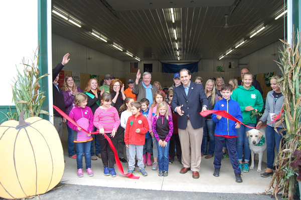 Assemblyman Michael J. Norris cuts the ribbon for a new agriculture education building.