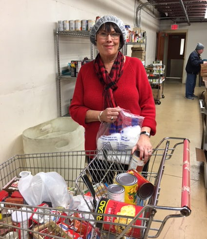 Rotarian Pat Barrows coordinated the Rotary Club of Lockport's volunteer effort at the Salvation Army's turkey dinner on Monday, Dec. 4.