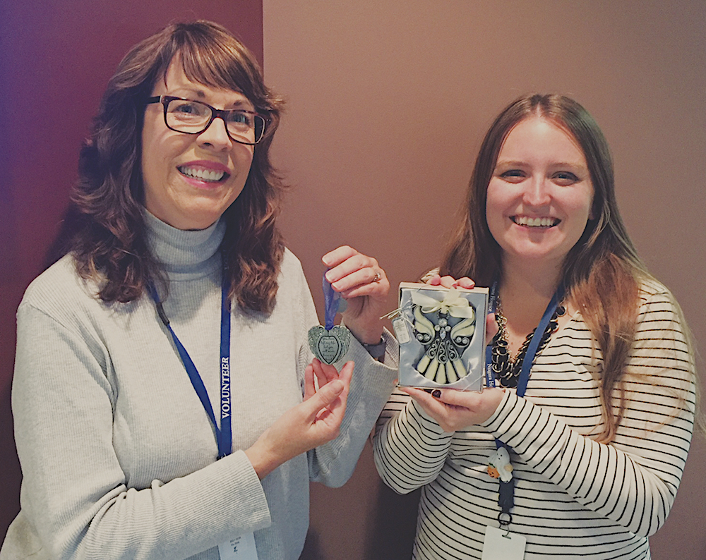 From left: Niagara Hospice volunteer Kathy Howard and volunteer coordinator Lisa Schmidt are pictured showing some of the additional holiday ornaments that will be available at the Dec. 7 Light-a-Life Tree Lighting. The family event is open to the community.