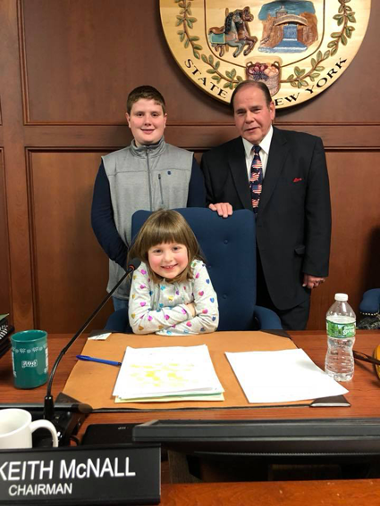 Legislature Chairman Wm. Keith McNall, R-Lockport, enjoys a moment of levity with granddaughter, Madyson McNall, and grandson, Jacob McNall, before being sworn into a new term as head of the county government.