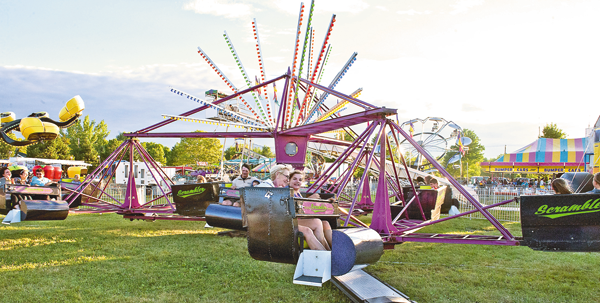 Families enjoy one of the rides at the Niagara County Fair.