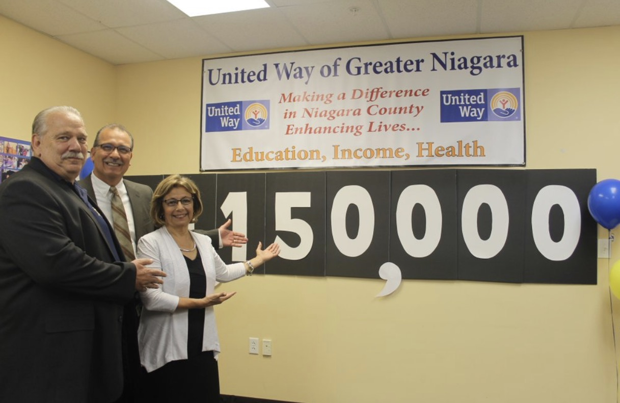 From left, next to the United Way's 2017 goal: Jim Briggs, subdirector of United Steel Workers; William Tiger, plant manager of GMCH Lockport operations; and Connie Brown, president and CEO of UWGN.