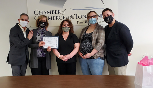 Pictured, from left:  Steve Schiavone, Kathy Carr, Chamber of Commerce of the Tonawandas Director of Marketing and Membership Sarah Nelson, Katie Carr Stuermer and baby Zach Carr.