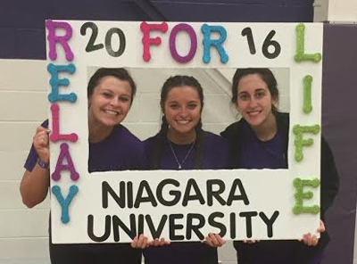 Members Morgan Miller, Elisha Nicosia and Meghan Barone support the fight against cancer.