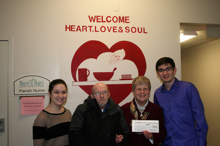 CEO Club HR director Jessica Mullane, far left, and C.E.O. Club president and treasurer Robert Derrett, far right, deliver a check to Heart, Love and Soul guest James and executive director Sister Beth Brosmer.